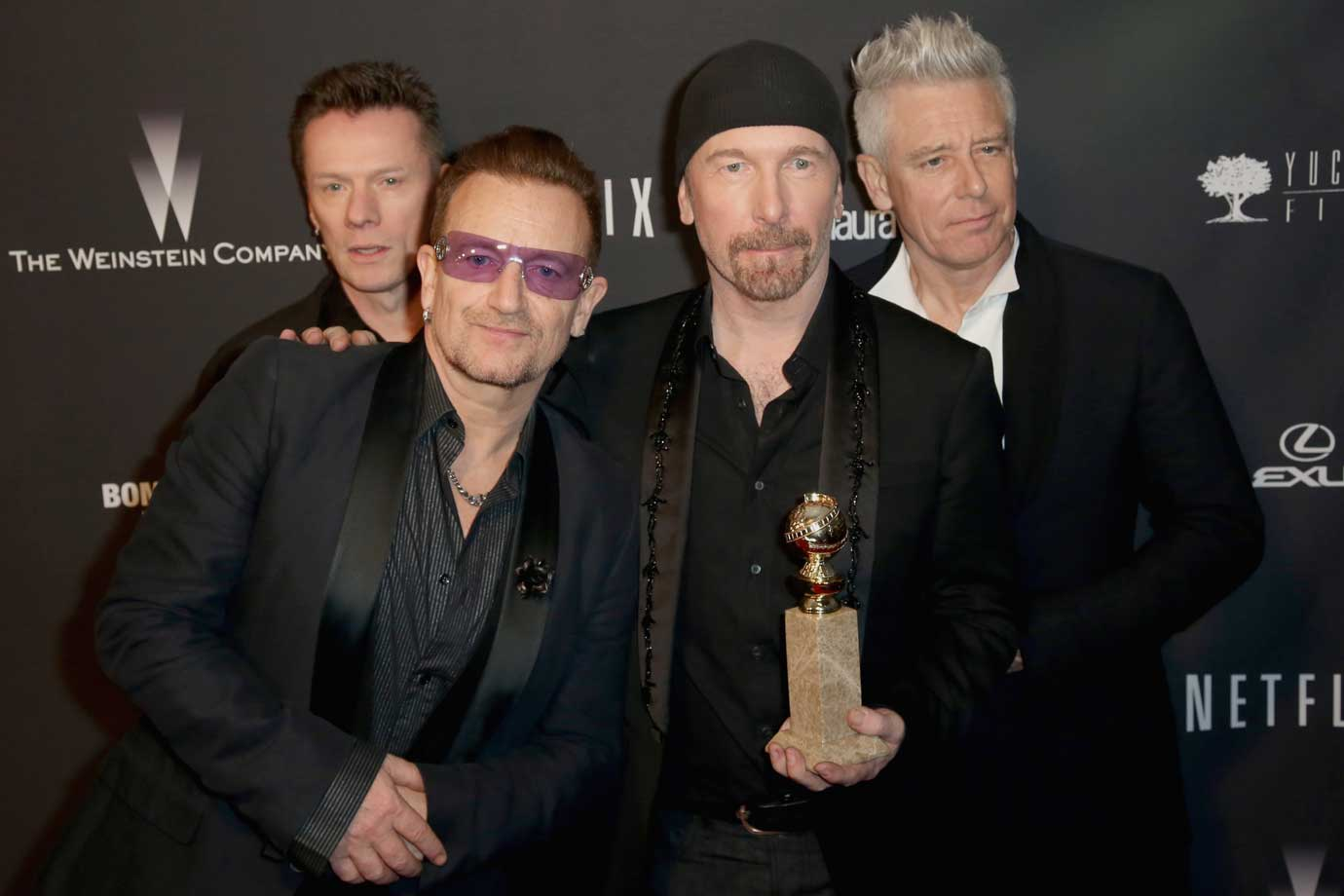Integrantes do U2, Larry Mullen, Jr.,Bono, The Edge e Adam Clayton, em 2014