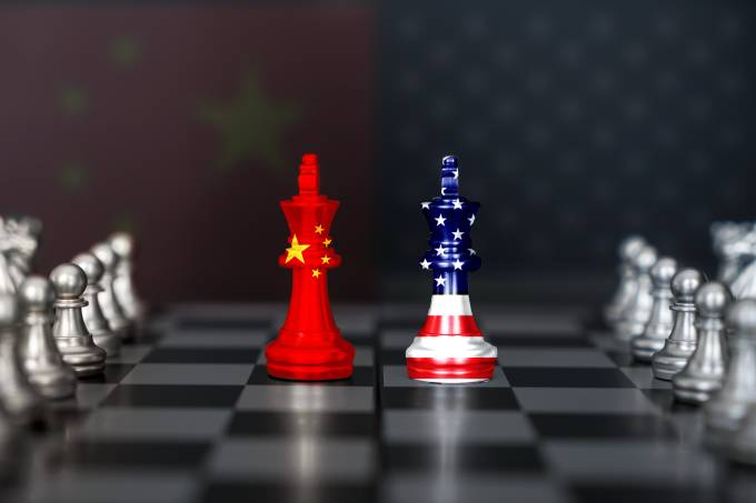 USA and China trade relations, cooperation strategy. US America and China flags on chess king on a chessboard.