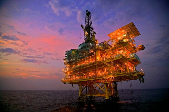 Nightime view of an offshore drilling rig and production platform in the Gulf of Mexico.